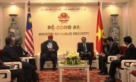Thu truong Le Quy Vuong tiep Tong giam doc Co quan thuc thi phap luat Hang hai Malaysia - Anh 1
