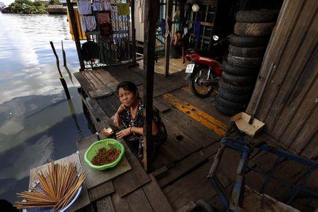Nguoi Sai Gon song lan lon trong 20.000 can nha 'xom nuoc den' - Anh 7