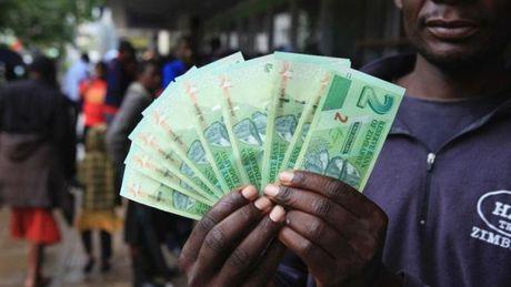 Zimbabwe phat hanh tien trai phieu giam tinh trang thieu tien mat - Anh 1