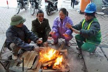Khi lanh tang cuong: Ha Noi ret dam, mien Trung mua to - Anh 1