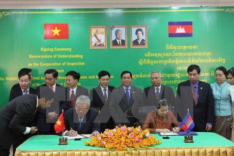 Viet Nam va Campuchia tang cuong hop tac trong linh vuc thanh tra - Anh 1