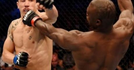 """UFC: Doi thu nga, tung seri 20 dam nhu """"gia gao"""" - Anh 1"""