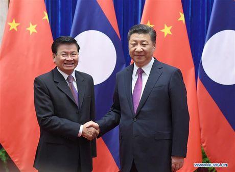 Trung Quoc muon tang cuong quan he doi tac ben chat voi Lao - Anh 1