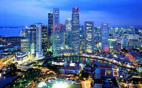 Singapore giam muc thuong cuoi nam do kinh te suy giam - Anh 1