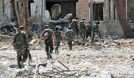 Quan doi Syria tiep tuc tan cong tren ca 2 huong dong, nam Aleppo - Anh 1