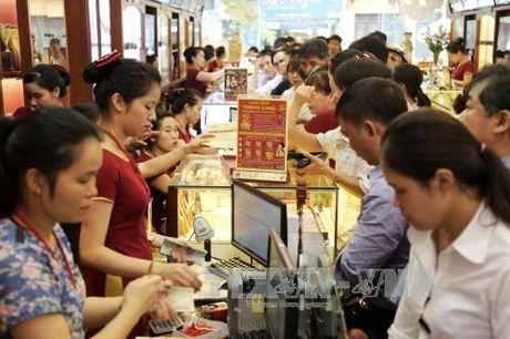 Gia vang phien cuoi tuan tang tren 100.000 dong/luong - Anh 1