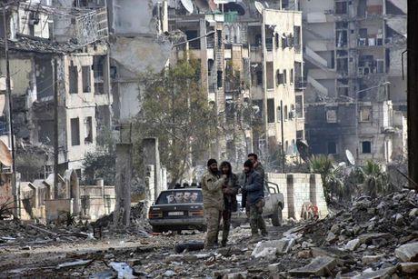 Nga tim thay nhieu ho chon tap the tai Dong Aleppo cua Syria - Anh 1