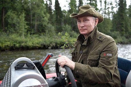 Tong thong Putin coi tran nghi mat tai Siberia - Anh 9