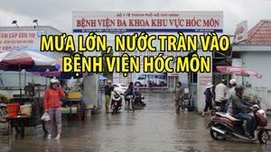Bệnh nhân khổ sở vì nước ngập đã tràn vào Bệnh viện Hóc Môn