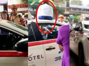Nữ tài xế taxi mặc váy leo nóc xe 'ăn vạ' CSGT