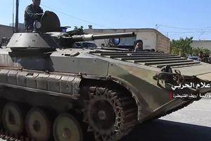 Nga: Phiến quân ở tây nam Syria giao nộp xe chiến đấu hạng nặng cho SAA
