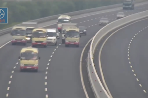 Đoàn xe khách dàn hàng ngang trên cao tốc Hà Nội - Hải Phòng