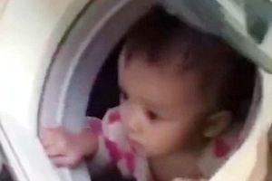 Bé 1 tuổi trốn trong máy giặt, thoát khỏi vùng lũ nguy hiểm